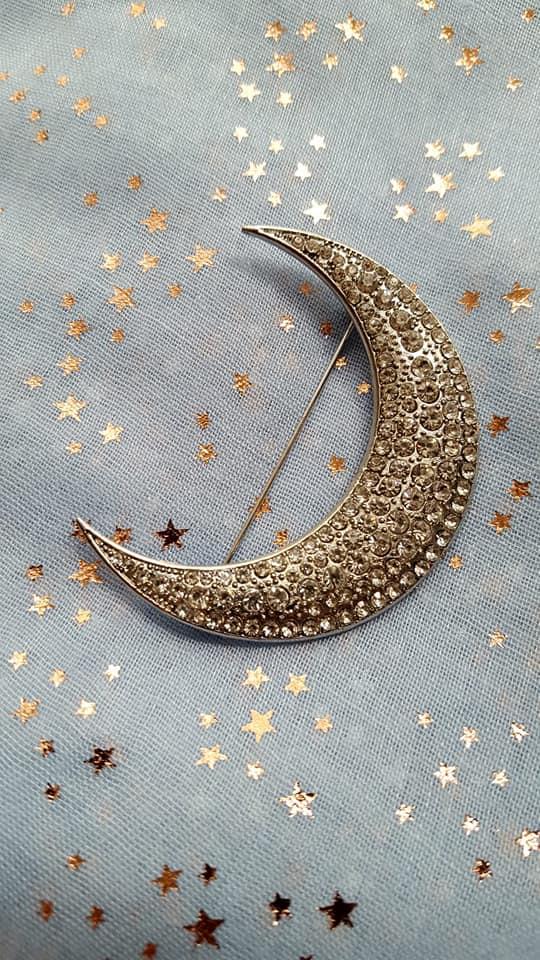 A half-moon brooch